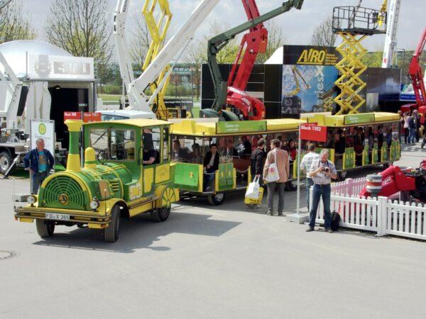 City Bahn Jumbo grün gelb Wegebahn mieten Betriebsbesichtigung