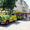 City Bahn Jumbo grün gelb Wegebahn mieten Parkplatztransfer
