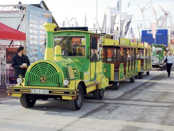City Bahn Jumbo grün gelb Wegebahn mieten Werksführung