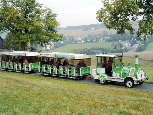 City Bahn Jumbo grün weiß Seiffner Bimmelbahn mieten Seiffen Erzgebierge