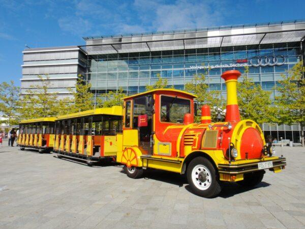 City Bahn Jumbo rot gelb Messebahn mieten