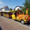 City Bahn Jumbo rot gelb Messebahn mieten Tragesers Apfelwein Äbbelwoi Express Ebbelwei