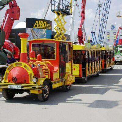 City Bahn Jumbo rot gelb Messebahn mieten bauma Express Messe München