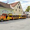 City Bahn Jumbo rot gelb mieten Wiesn Bockerl Herbstfest Rosenheim