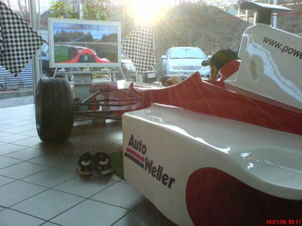 Formel 1 Rennsimulator rot weiss mieten Autohaus