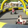 Kinderfahrschule Curvemaster Fahrzeugmanege in aufblasbarer Sicherheitsumrandung
